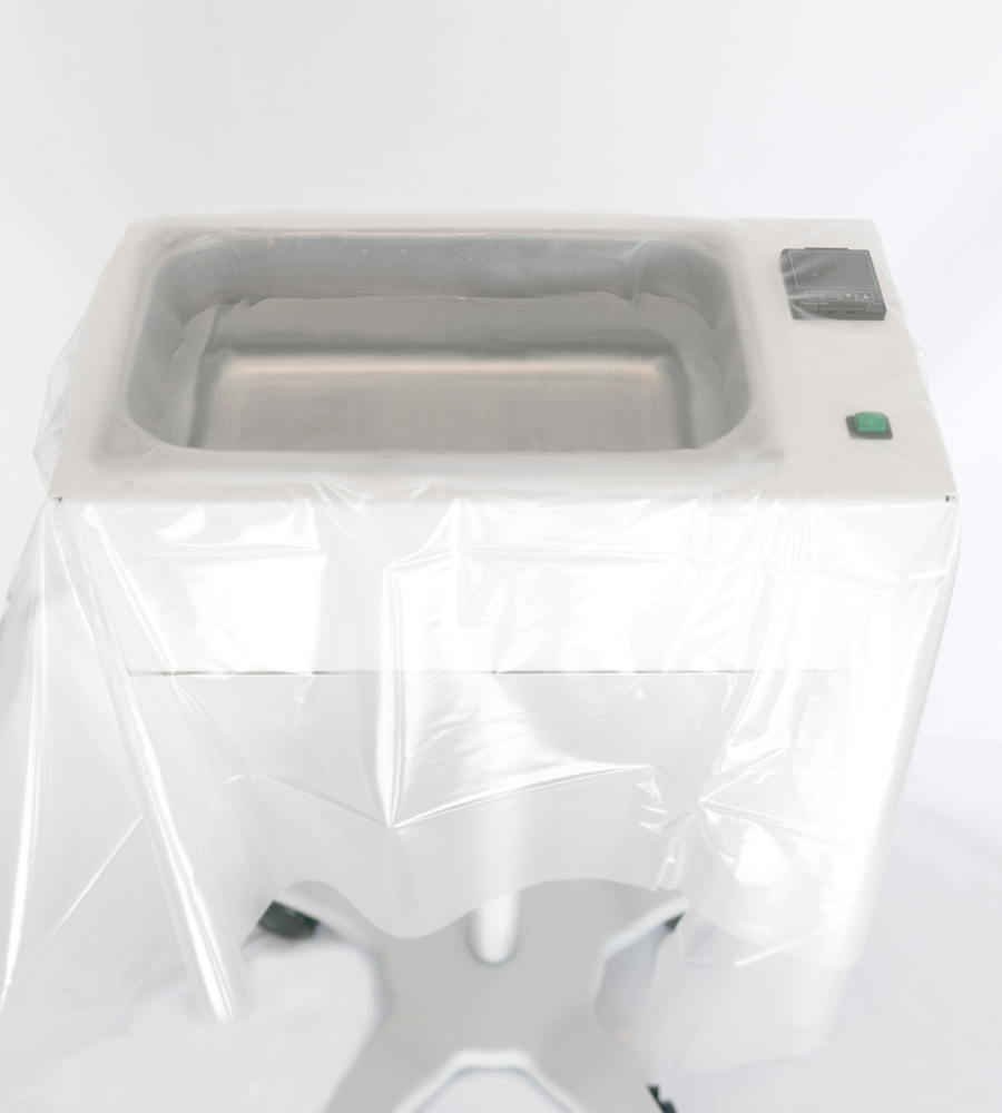 full product photo of one degree medical's irrigation fluid warmer with plastic over it